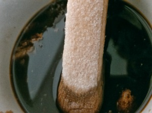 Lady Finger Biscuits being dipped into the coffee-cocoa mixture