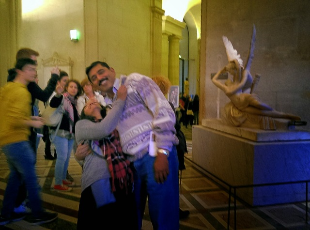 My parents trying to copy the pose of the statue behind them